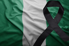 Flag of nigeria with black mourning ribbon Royalty Free Stock Images