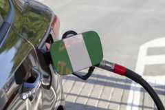 Flag of Nigeria on the car`s fuel filler flap. royalty free stock images