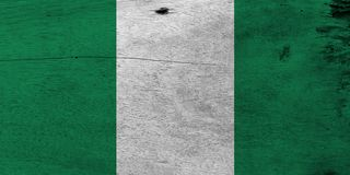 Flag of Nigeria on wooden plate background. Grunge Nigerian flag texture. royalty free stock images