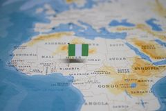 The Flag of nigeria in the world map stock photos