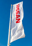 The flag of Nissan over blue sky Royalty Free Stock Images