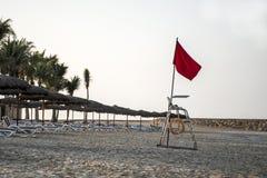 Flag no swimming danger sign at beach souly bay salalah Oman  Royalty Free Stock Image