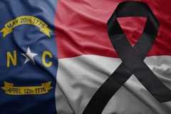 Flag of north carolina state with black mourning ribbon Royalty Free Stock Image