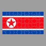 Flag of North Korea from puzzles on a gray background. stock illustration