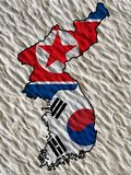 Flag of North Korea and south Korea on a wall background. stock photography