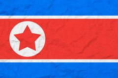Flag Of North Korea. Vintage style. Old wall texture. Faded background. Stock Images