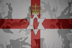Flag of northern ireland on the khaki texture . military concept Royalty Free Stock Image