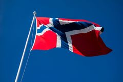 Flag of Norway flapping in wind. stock image
