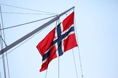 Flag of Norway on the mast of the ship stock photography