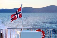 Flag of Norway mounted on stern railings. Of fast passenger ferry Stock Photography