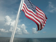 Flag and Ocean. A flag over the sea Stock Photo