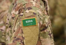 Free Flag Of Saudi Arabia On Soldiers Arm Collage Royalty Free Stock Images - 133044879