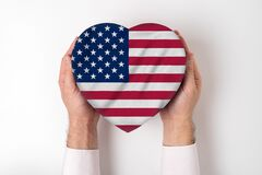 Free Flag Of USA On A Heart Shaped Box In A Male Hands. White Background Royalty Free Stock Photo - 170454665