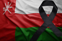 Flag of oman with black mourning ribbon. Waving national flag of oman with black mourning ribbon Royalty Free Stock Photo