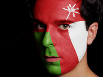 Flag of Oman. Painted on a Face of a Young Man Royalty Free Stock Photos