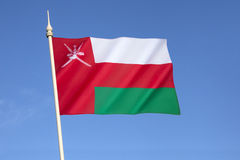 Flag of Oman. Until 1970, Oman used the plain red banner of the indigenous people. In 1970, the Sultan introduced a national flag. Bands of green and white Stock Images