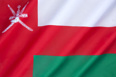 Flag of Oman. Until 1970, Oman used the plain red banner of the indigenous people. In 1970, the Sultan introduced a national flags. Bands of green and white Stock Photo
