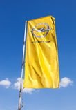 The flag of Opel over blue sky Stock Image