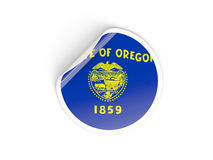 Flag of oregon, US state round sticker Stock Images