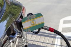Flag of Organisation of African Unity on the car`s fuel filler flap. stock images