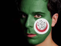 Flag of Organisation of Islamic Cooperation. Painted on a Face of a Young Man Royalty Free Stock Image