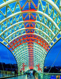The flag over the bridge. TBILISI, GEORGIA - MAY 28, 2016: The glass tent of the Peace Bridge illuminated in colors of National Flag of Georgia, on May 28 in Stock Image