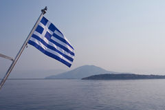 Flag over islands Stock Photography