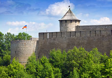 Flag over Ivangorod fortress at the border of Russia and Estonia Royalty Free Stock Photo