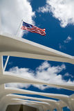 Flag over the U.S.S. Arizona. US flag over the U.S.S. Arizona Memorial in Pearl Harbor, Hawaii royalty free stock images
