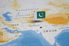 The Flag of pakistan in the world map stock photo