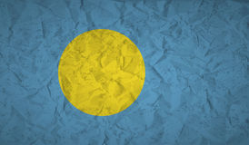 Flag of Palau with the effect of crumpled paper and grunge Stock Photography