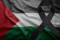 Flag of palestine with black mourning ribbon. Waving national flag of palestine with black mourning ribbon Royalty Free Stock Photos