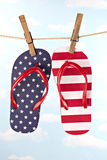 Flag patterned flip flop shoes hanging Stock Images