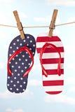 Flag patterned flip flop shoes hanging Stock Images