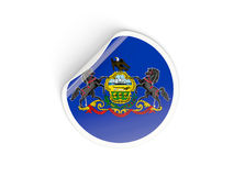 Flag of pennsylvania, US state round sticker Stock Images