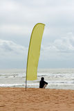 Flag and person on beach Stock Photography