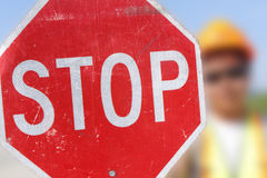 Flag Person Holds Stop Sign Royalty Free Stock Photo