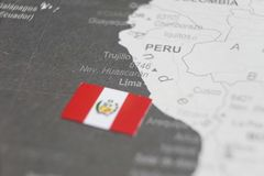 The flag of Peru placed on Lima map of world map.  royalty free stock photos