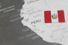 The flag of Peru placed on Peru map of world map.  stock images