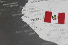 The flag of Peru placed on Peru map of world map.  royalty free stock photo