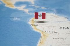 The Flag of peru in the world map.  stock image