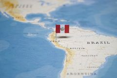 The Flag of peru in the world map.  stock photo