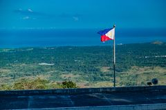 The Philippine flag. The Flag of the Philippine Island with a landscape background stock image