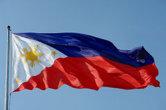 Flag of the Philippines. Over an azure blue sky Royalty Free Stock Photo