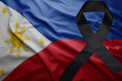 Flag of philippines with black mourning ribbon. Waving national flag of philippines with black mourning ribbon Royalty Free Stock Photography