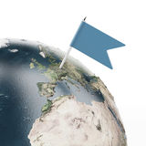 Flag pin at the globe (Earth map provided by NASA) Stock Images