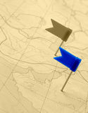 Flag a pin on old map Royalty Free Stock Image