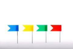 Flag pins. Four flag pins on white Royalty Free Stock Photo