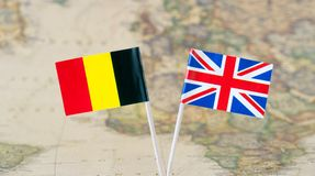 Flag pins of leader countries Belgium and Great Britain UK, concept image Stock Image