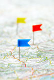 Flag pins on a map Royalty Free Stock Image